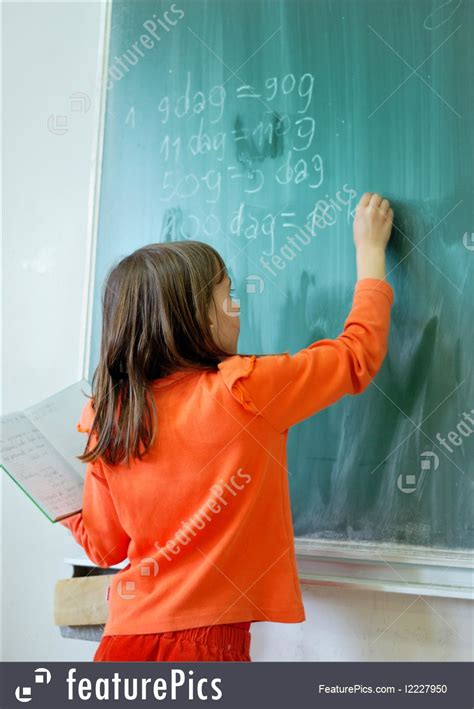 education girl writing  school board stock image