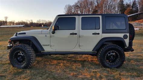 sahara tan aev jeep wrangler jk lifted  tires