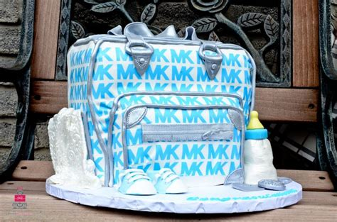 michael kors diaper bag baby shower cake  frosted