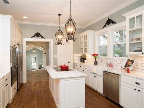 wood floors in a kitchen cottage kitchen with hardwood floor and white cabinets hgtv 1937