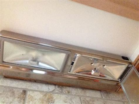 replacing direct wire halogen cabinet fixtures with