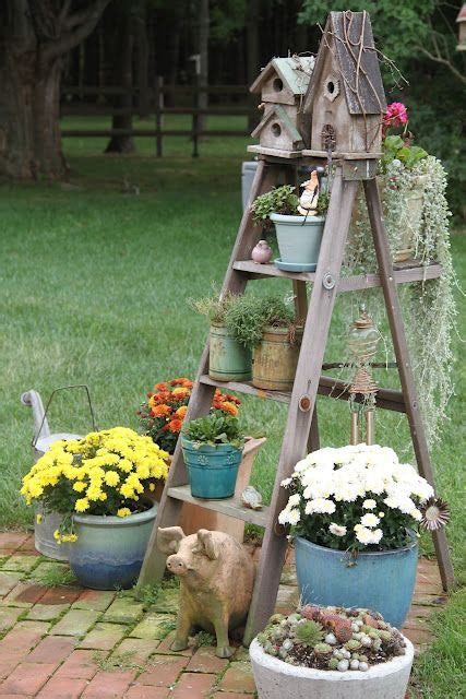diy backyard decorating ideas ladder dressed with birdhouses plants