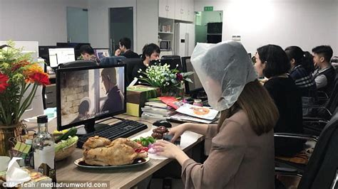 cooking at your desk chinese woman roasts whole chicken at her desk in office