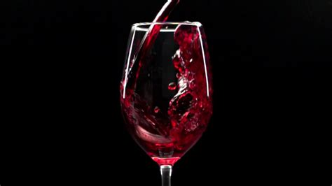 Wine Background Wine Is Poured Into A Glass Against Black Background