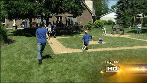 Family, Friends Enjoy Wiffle Ball Field