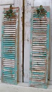Decorative repurposed shutters wall decor from