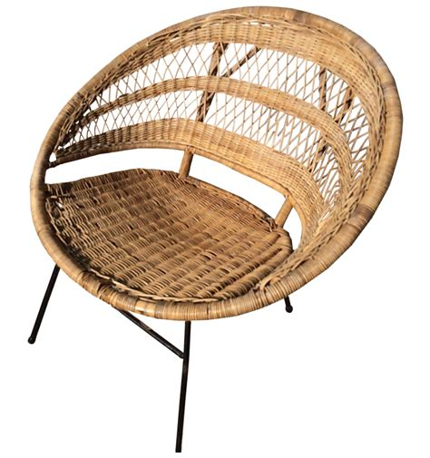 It's made with a slender metal frame, and has a seat and back covered in wicker rattan. Mid-Century Modern Rattan Scoop Chair | Chairish