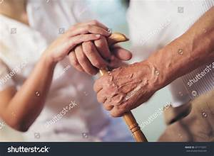 Young Woman Holding Hand Old Man Stock Photo 471715331 ...