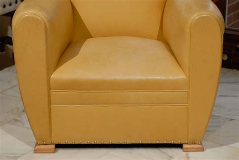 handsome deco club chairs in yellow ochre leather at
