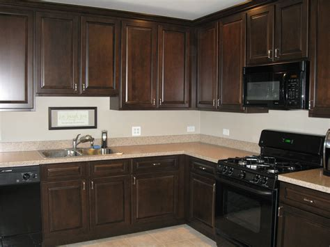 paint or stain oak kitchen cabinets staining oak cabinets cherry savae org 9048