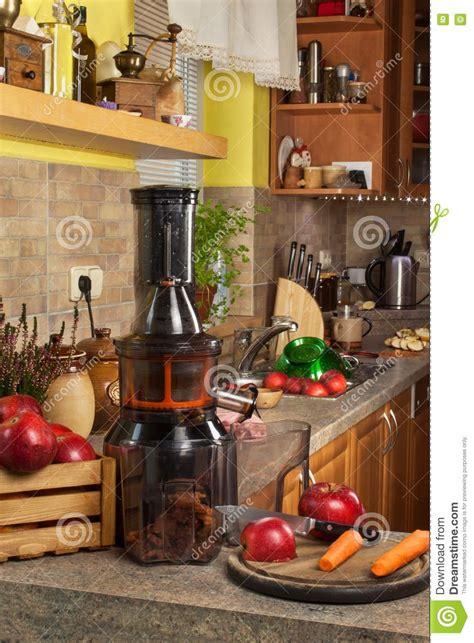 juices juicing juicer apples autumnal preparing processing juice fruit fresh apple healthy kitchen homemade lifestyle
