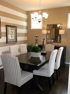 Traditional dining room with a striped accent wall ...