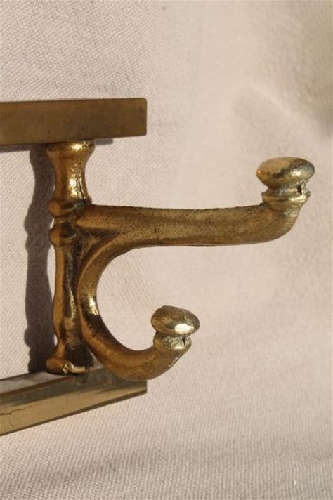 vintage mug rack  wall hanging coat hanger peg board solid brass  brass hooks