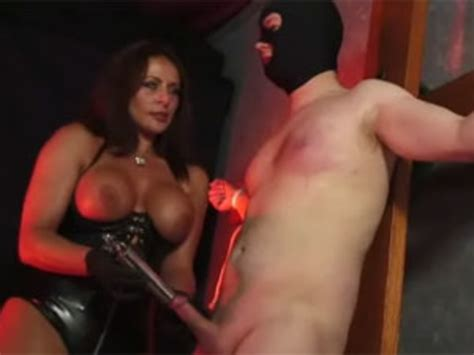 Wild Busty Mistress In A Latex Corset Whipping Her Roped