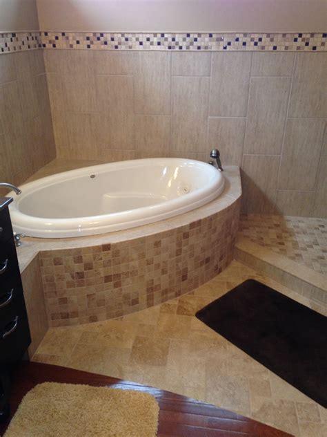 corner tub  curved tile surround bathtub remodel