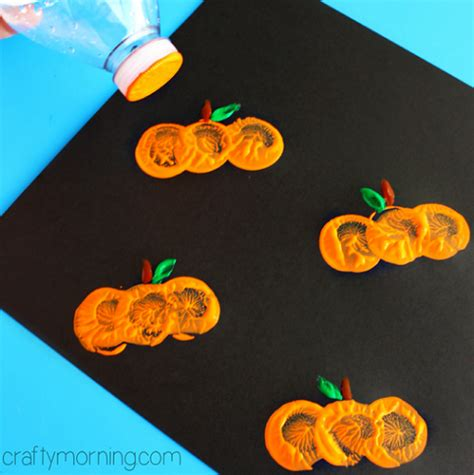 easy pumpkin crafts for to make this fall crafty 679 | bottle cap pumpkin stamping craft for kids