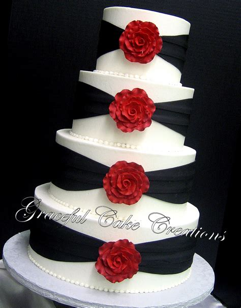Elegant White And Black Wedding Cake With Red Roses A