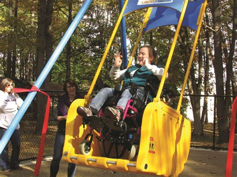 handicap swing ribbon cutting held for handicap accessible liberty swing