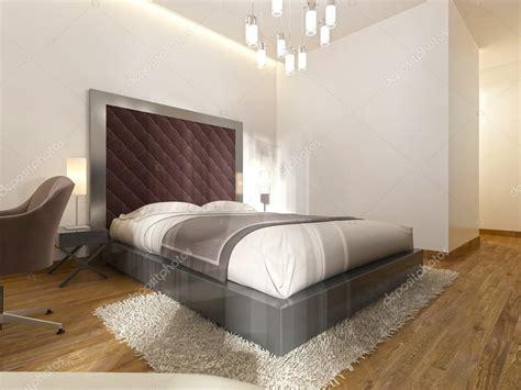 luxueux lit double dans la chambre dhotel dans le style