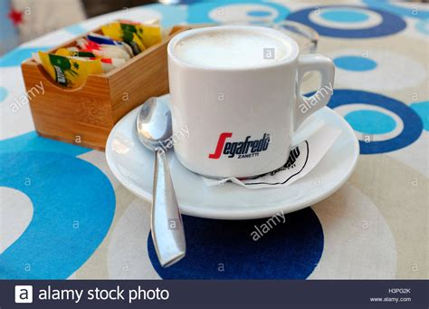 Just at that moment, an italian man passed through the kitchen (to check on the coffee making, i suppose). segafredo italian coffee brand, bosa, sardinia, italy Stock Photo: 122812107 - Alamy