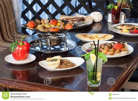 vernis table cuisine beautifully set table with a different meal stock photo