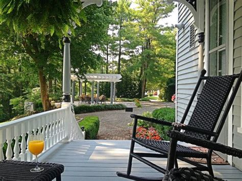 southern style wrap around porch with view of nearby