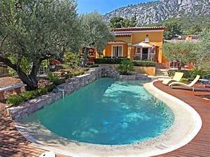 Piscines formes libres diffazur piscine avec mur en for Piscine forme libre avec plage 3 plage immergee et piscine diffazur piscines