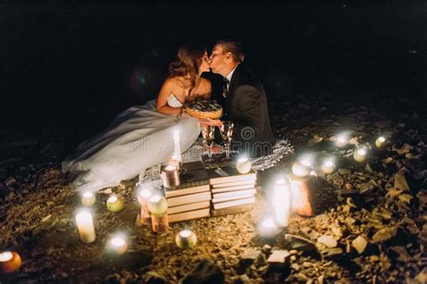 loving couple kissing  romantic dinner  candles