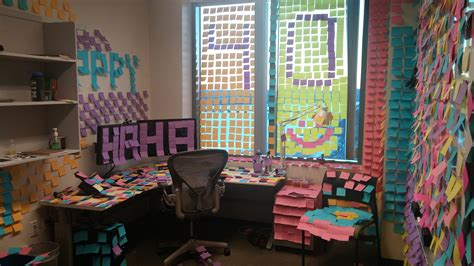 bureau post it task of the week cover an office with post it notes