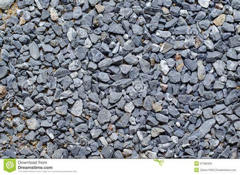 grey crushed granite pebbles background image stock photo