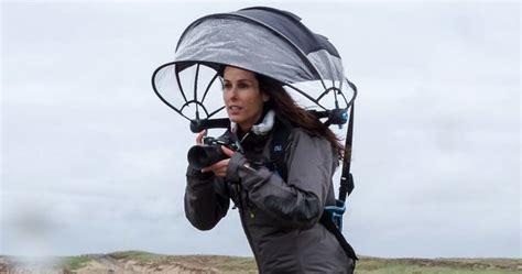 innovative hands  umbrella    camera dry