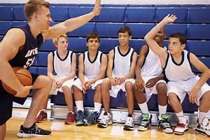 Male High School Basketball Team Having Team Talk With ...