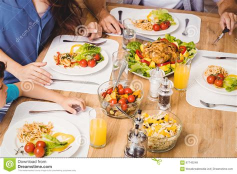 cuisine dinette parents child family healthy food at dining table stock