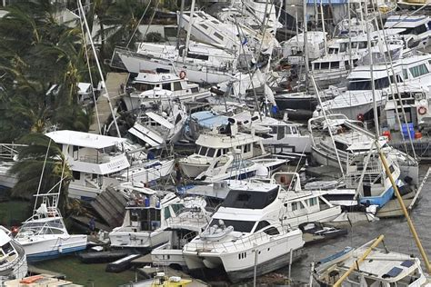 damaged boats   port hinchinbrook marina abc news