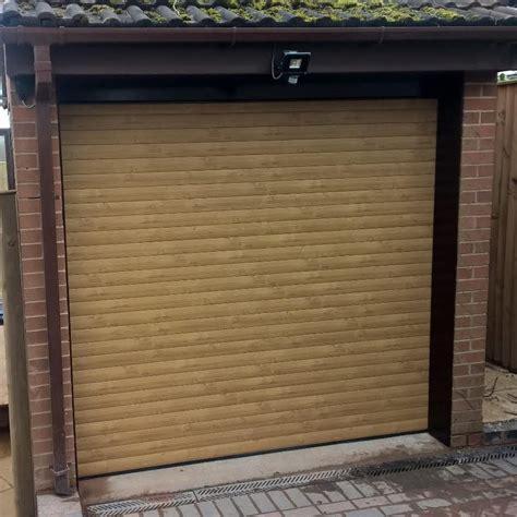 irish oak  automated roller garage door installed