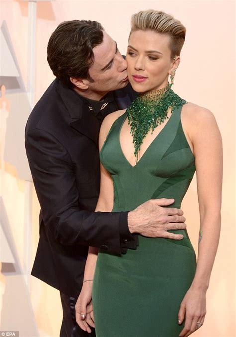 Scarlett Johansson gets a surprise kiss from John Travolta ...