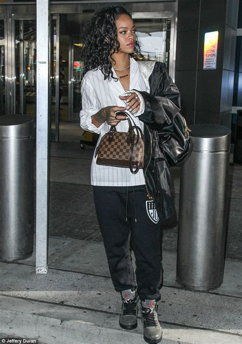 rihanna  worth  million  carries  expensive louis vuitton purse  nyc daily