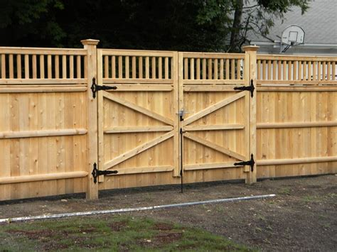 privacy fence driveway gate fence company  ma builds  double drive gate  double drive