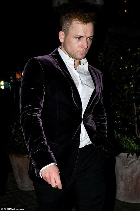 Taron Egerton looks disheveled and worse-for-wear as he ...