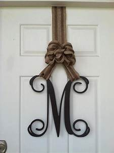 this is an interesting way to hang your single letter With letters to hang on front door