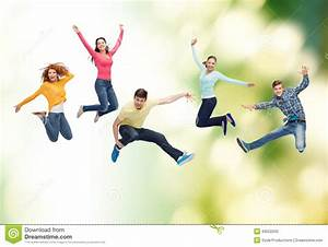 Group Of Smiling Teenagers Jumping In Air Stock Photo ...