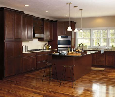 our oak lazy maple cabinets in casual kitchen aristokraft
