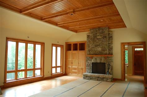 cherry stained pine trim     , fireplace, stone, eagle