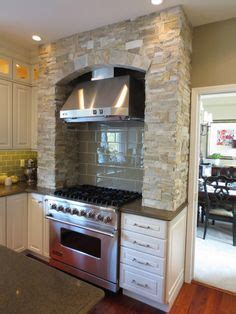 world kitchen cabinets surrounds gas cooking stove in this traditional 3663