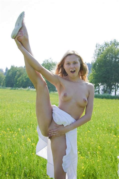 Sexy Blonde With Long Hair Posing On The Grass