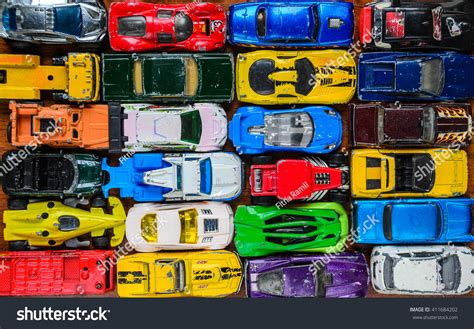 Many Multi-colored Toy Cars Stock Photo 411684202