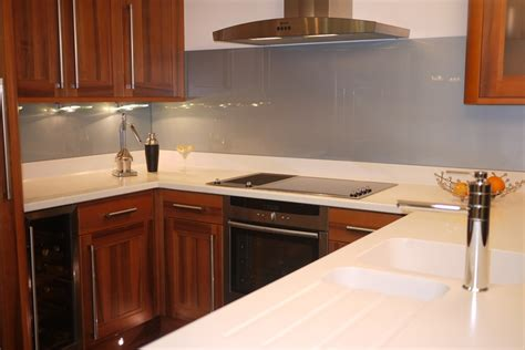 a silver grey glass splashback teamed up with white