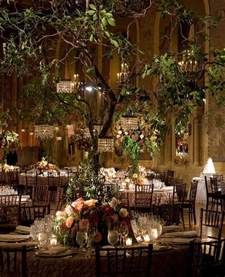 unique wedding reception locations indoor garden wedding trees with mini chandeliers