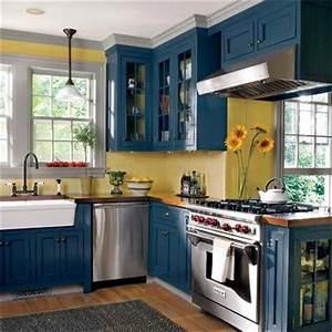Editors39 picks our favorite cottage kitchens cabinets for Kitchen cabinets lowes with university of michigan wall art