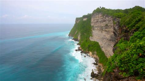 waves   indian ocean break  coastal rocks bali